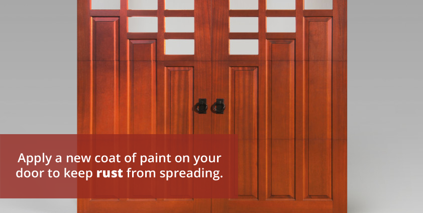 Apply a new coat of paint on garage door to keep rust from spreading.